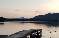 Lake, pier and soft sky